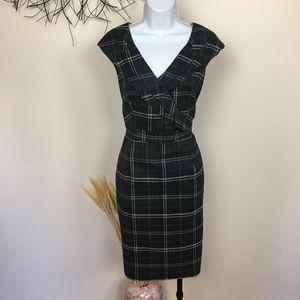 Plaid sleeveless midi dress. Work career. Ruffle